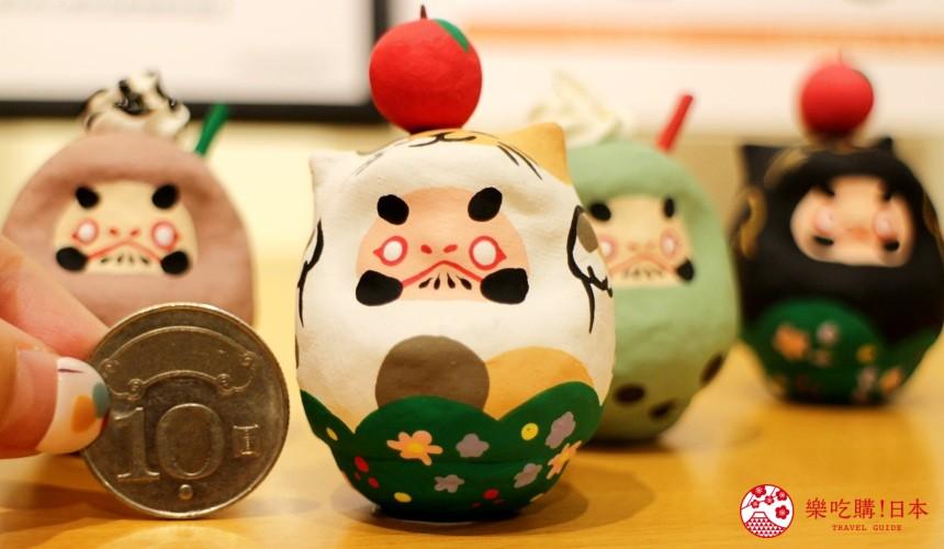 台北東區選物店MiCHi Cafe限量販售的許願達摩頂著蘋果的貓造型不倒翁日本名產伴手禮傳統工藝品推薦商品